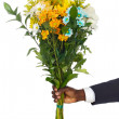 Hand giving flowers — Stock Photo
