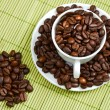 Coffee beans in a cup - Stock fotografie