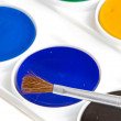 Box of watercolors with brush — Stock Photo