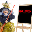 Royalty-Free Stock Photo: Witch whit slate and text halloween