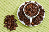 Coffee beans in a cup — 图库照片