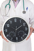 Doctor with big clock — Stock Photo
