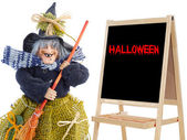 Witch whit slate and text halloween — Stock Photo
