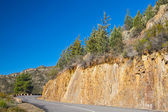 Mountain road with sharp curve — Stock Photo