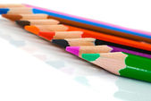 Colored pencils lined up -Shallow DOF — Stock Photo