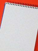 Photo of one notebook in blank with blue squares — Stock Photo