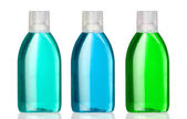 Three bottles of mouthwash — Stock Photo