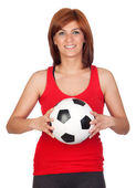 Beautiful redhead girl with a soccer ball — Stock Photo