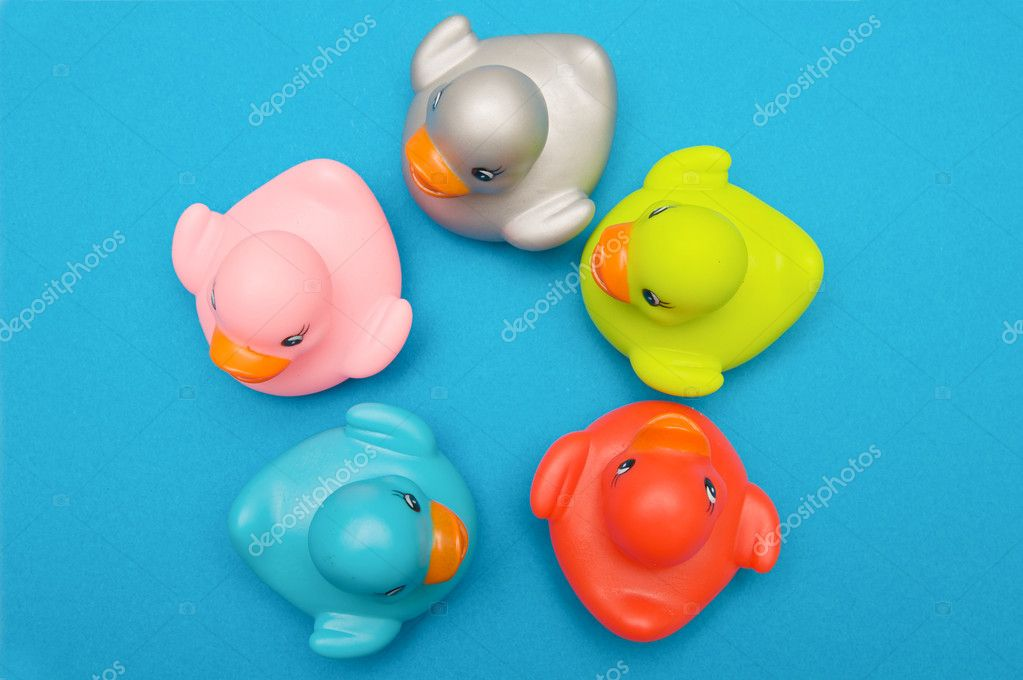 Five ducks plastic multi-colored watched from above — Stock Photo #9441541