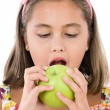 Adorable girl with flowered dress eating a apple — Stock Photo #9497155