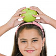 Adorable girl with a apple on her head - Stock Photo