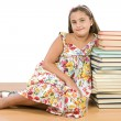 Adorable girl with many books - Stock Photo