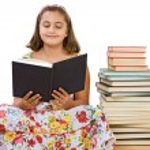 Adorable girl reading — Stock Photo #9497187