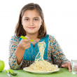 Precious girl eating spaghetti — Stock Photo