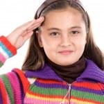 Beautiful girl doing a military salute — Stock Photo