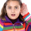 Adorable girl hearing — Stockfoto