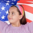 Patriotic little girl with american flag - Stock Photo