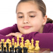 Attractive little girl playing chess — Stock Photo