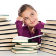 Adorable girl with many books thinking — Stock Photo