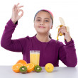 Cute girl with many fruits — Stock Photo #9497487