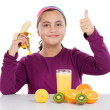Cute girl with many fruits — Stock Photo #9497488