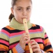 Adorable girl playing flute — Stock Photo