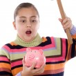 Surprised girl with moneybox and hammer — Stock Photo #9497536