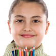 Stock Photo: Adorable girl with many crayons of colors