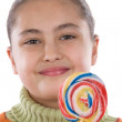Adorable girl with a lollipop — Stock Photo #9497590