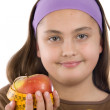 Cute girl with a apple with tape measure — Stock Photo