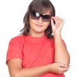 Adorable preteen girl with sunglasses — Stock Photo