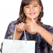 Adorable preteen girl shopping saying OK - Stock Photo