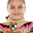 Little girl playing with a colorfull cube — Stock Photo #9497726