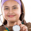 Little girl doctor making examining — Foto Stock