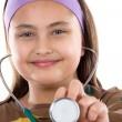 Little girl doctor making examining — Stock Photo #9497730