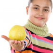 Cute girl with a apple. Focus on apple and DOF — Stock Photo #9497731