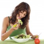 Teenager eating salad — Stock Photo #9498910
