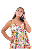 Adorable girl speaking by phone — Stock Photo