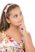 Adorable girl with flowered dress thinking — Stock Photo