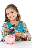 Adorable girl with money box — Stock Photo