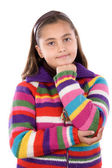 Adorable girl with woollen jacket thinking — Stock Photo