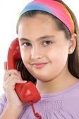 Beautiful girl with red telephone — Stock Photo
