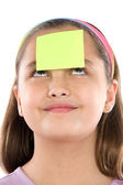 Adorable girl with post-it in her front — Stock Photo