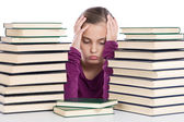 Adorable girl concentrated with many books — Stock Photo