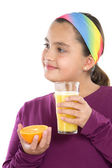 Cute girl drinking juice of oranges — Stock Photo