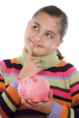 Adorable girl with moneybox thinking — Stock Photo
