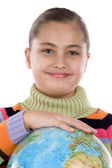 Adorable girl with a globe of the world — Stock Photo