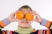 Attractive girl with mandarines — Stock Photo