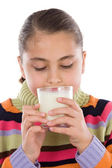 Girl drinking milk — Stock Photo