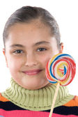 Adorable girl with a lollipop — Stock Photo